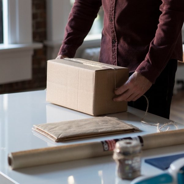 Person packing box to move out